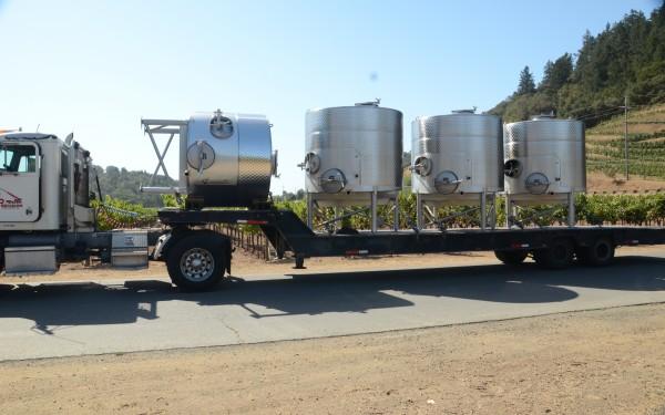Tank on a truck arrives at Odette Estate